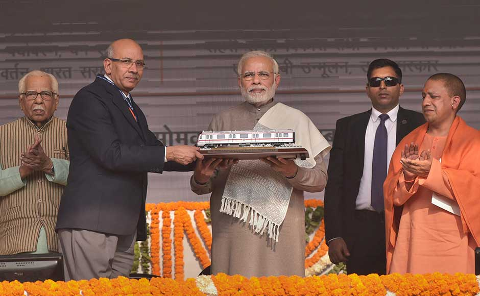 A stretch of Delhi Metro's Magenta Line was inaugurated by Prime Minister Narendra Modi on Monday, cutting down the travel time between Noida and parts of south Delhi by more than 30 minutes. Modi being presented a memento by Delhi Metro Chairman Manghu Singh. PTI