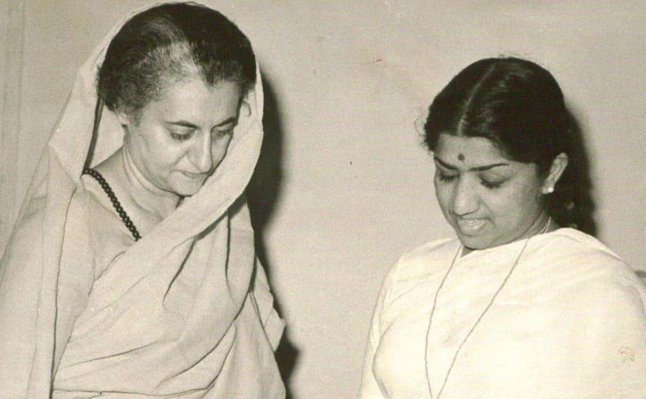Indira Gandhi receiving an LP recording of Meerabai's bhajans recorded in the voice of Lata Mangeshkar. IGMM