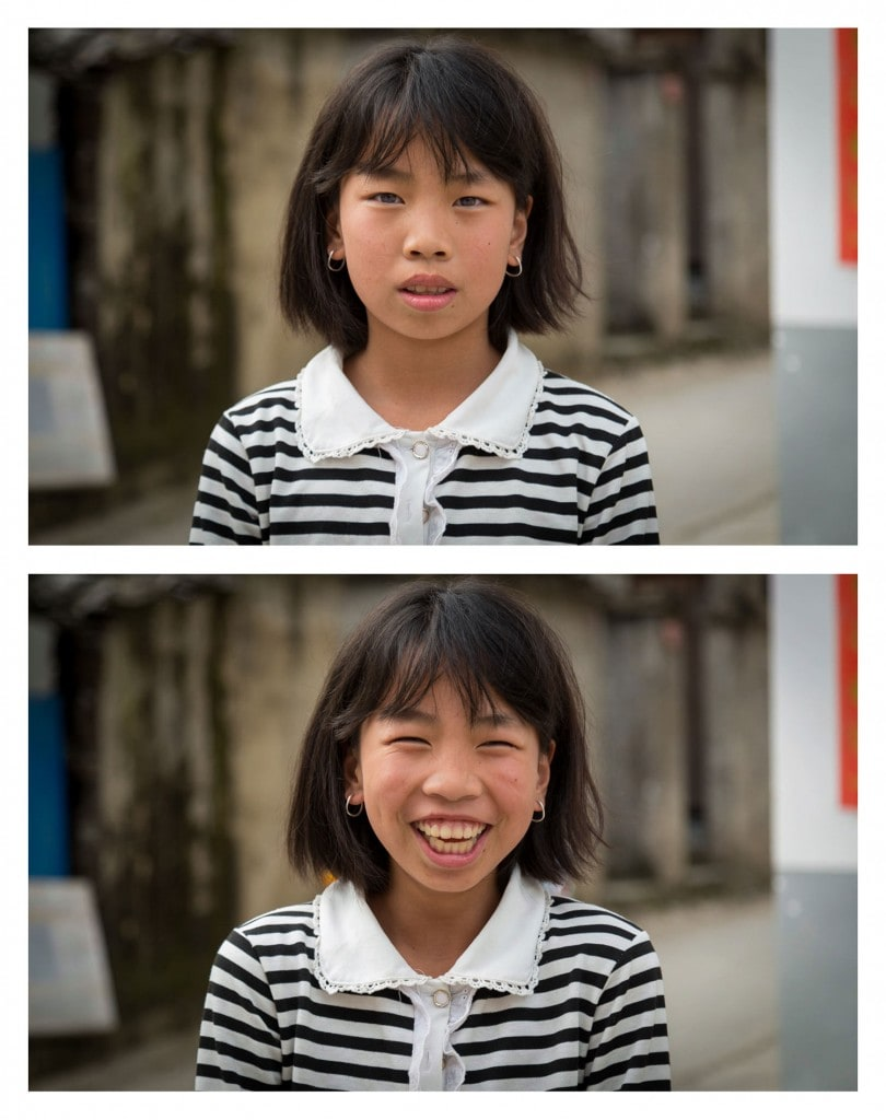 She was walking with her friend, watching me curiously, as I wandered the back streets of the quaint town of Fukou, in the mountains of Fuzhou, in Fujian, China… so I asked her to smile. Photo credit © Jay Weinstein