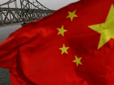 A Chinese flag is seen in front of the Friendship bridge over the Yalu River. Reuters
