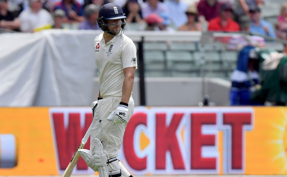 England's Dawid Malan walks off after he was adjudged LBW off the bowling of Australia's Josh Hazlewood for 14 runs. Replays showed that he had inside-edged it and a review would've saved him. AP
