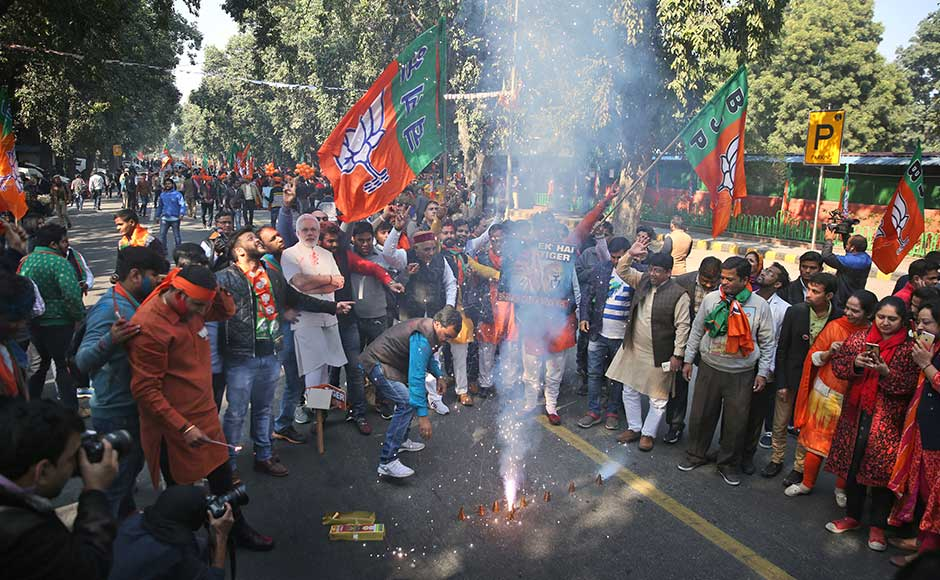 The Congress now rules only Karnataka, Punjab, Puducherry, Meghalaya and Mizoram. Among these, Karnataka, Meghalaya and Mizoram will have elections due next year. BJP supporters burn firecrackers to celebrate their party's win in two state assembly elections in New Delhi. AP