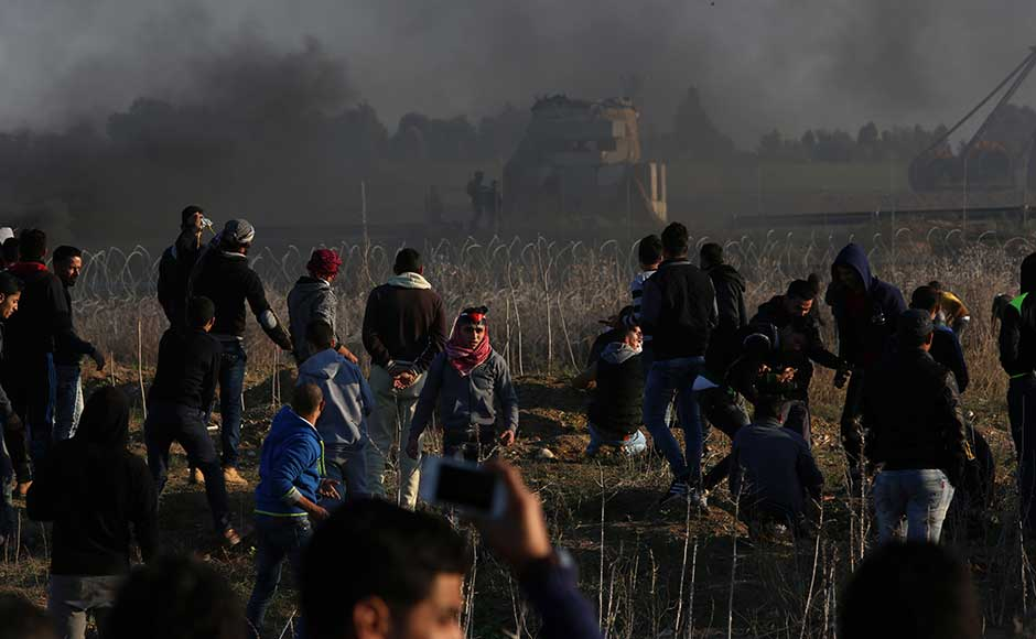 In Ramallah, the seat of the Palestinian government, protesters set tyres on fire, sending thick plumes of black smoke over the city. AP