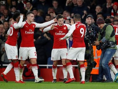 File image of Arsenal's Mesut Ozil celebrating a goal with teammates. Reuters