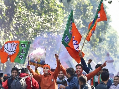 BJP workers and supporters celebrate success in Gujarat. PTI
