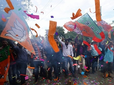 BJP workers celebrate the party's victory in Gujarat. PTI