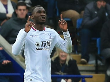 Crystal Palace's Christian Benteke celebrates after scoring the opening goal against Leicester City . AFP