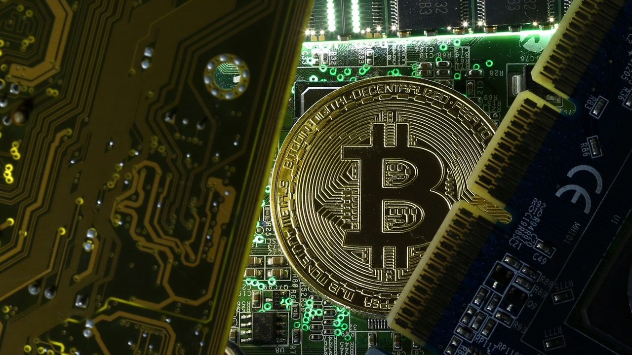 A copy of bitcoin standing on PC motherboard is seen in this illustration picture, October 26, 2017. Picture taken October 26, 2017. REUTERS/Dado Ruvic - RC1ADD827830