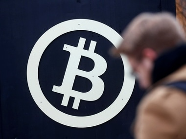 A bitcoin sign is seen during Riga Comm 2017, a business technology and innovation fair. Image: Reuters