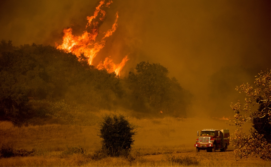 With gusts of up to 60 miles per hour (95 kilometers per hour), relentless seasonal winds had continued to stoke the fires on Friday, spitting embers and creating