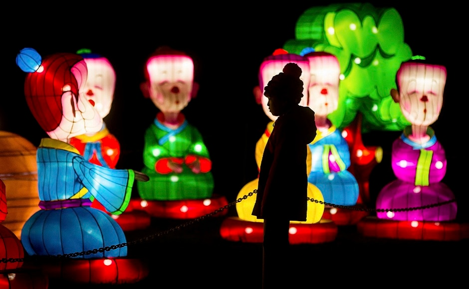 A young girl is silhouetted while viewing lanterns during the opening night of the Vancouver Chinese Lantern Festival at the Pacific National Exhibition, in Vancouver, British Columbia. AP