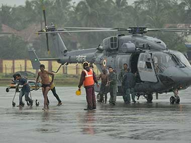 Fishermen who were stranded in the Arabian Sea due to Cyclone Ockhi get down from an Indian Navy helicopter after they were rescued in Thiruvananthapuram, Kerala. AP