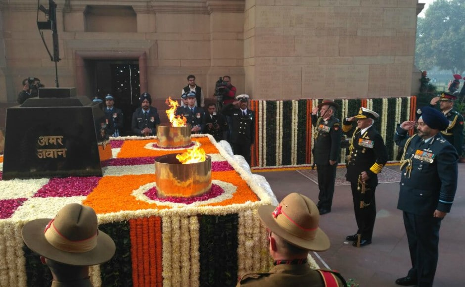 Navy chief Sunil Lanba, army chief General Bipin Rawat and air chief BS Dhanoa paid homage to martyrs at the Amar Jawan Jyoti at India Gate on the occasion of Navy Day. Image courtesy: Twitter / @indiannavy