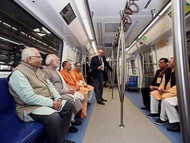 Prime Minister Narendra Modi takes a ride in a Delhi Metro train. PTI
