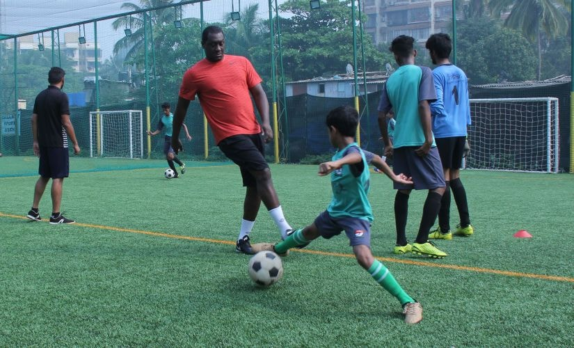Emile Heskey takes part in a coaching session with local kids in Mumbai.