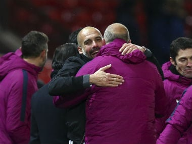 Manchester City boss Pep Guardiola celebrates with his coaching staff after beating Manchester United at Old Trafford. AFP