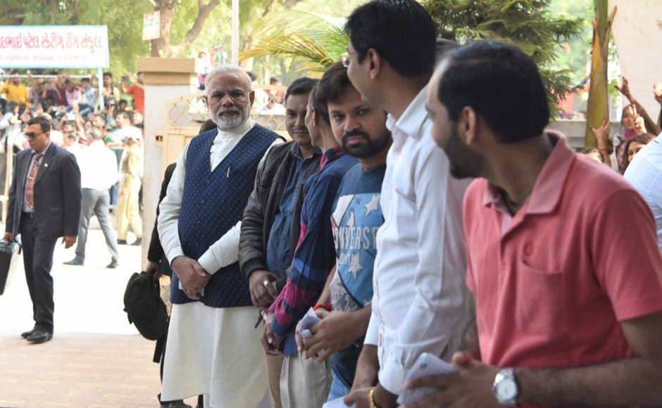 Modi cast his vote after waiting in a queue to exercise his right at a polling booth set up at a school in Sabarmati constituency of Ahmedabad district. Pallavi Rebbapragada