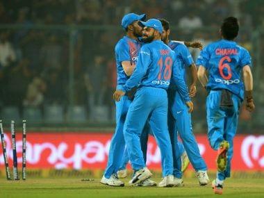 Virat Kohli celebrates the dismissal of New Zealand batsman Colin Munro during a T20 match in New Delhi. AFP