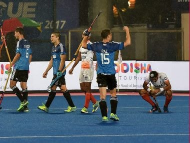 Argentina players celebrate their win against India during 1st semifinal match of Men's Hockey World league final at Kalinga Stadium in Bhubaneswar. PTI