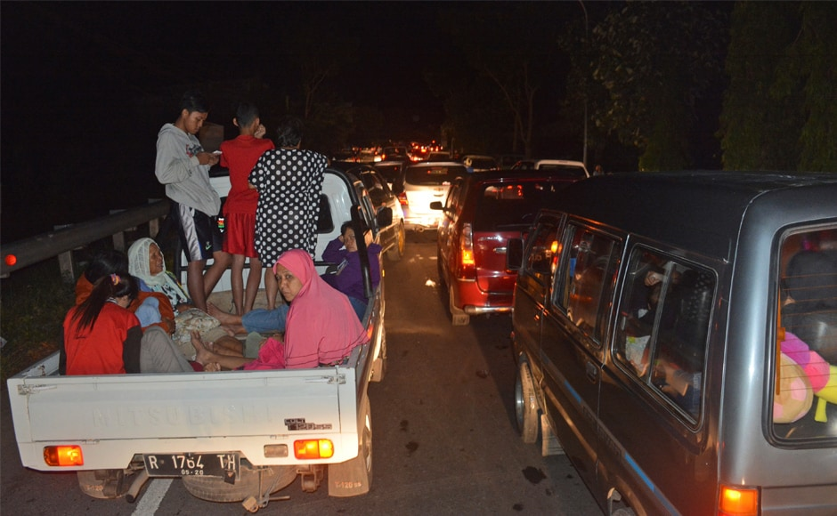 Vehicles stuck in traffic as people try to reach higher ground amid fears of a tsunami due to the earthquake. AP