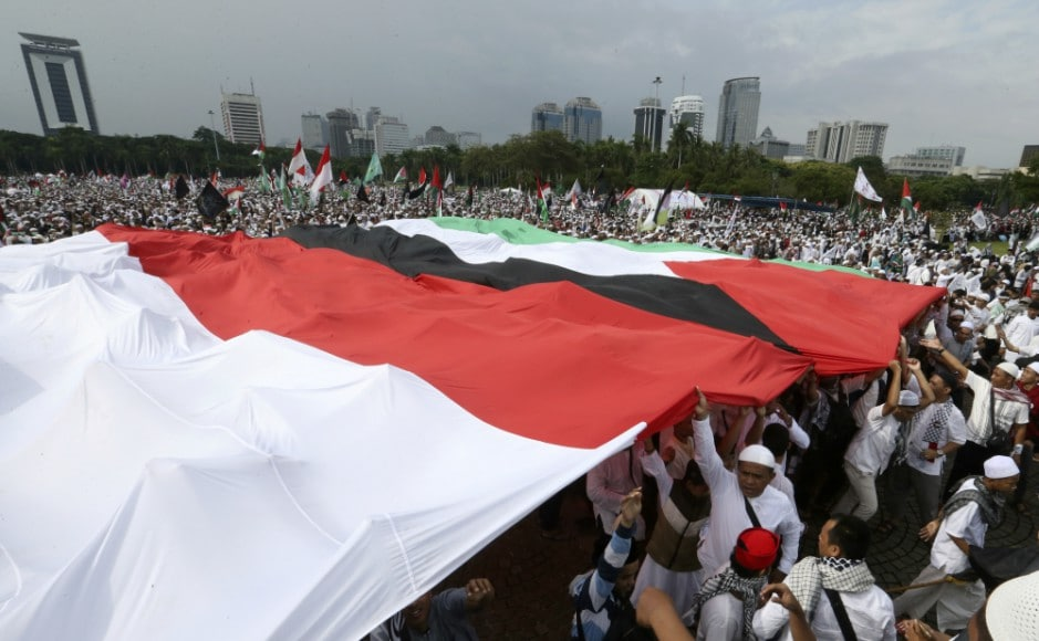 Around 80,000 protesters gathered at the National Monument, a tower that looms over central Jakarta, waving the Palestine flag and banners reading 'Free Palestine'. AP