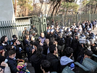 File image of anti-riot Iranian police preventing students from joining other protesters. AP