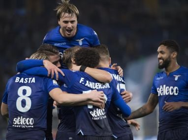 Lazio's Felipe Anderson celebrates with teammates after scoring his side's second goal. AP