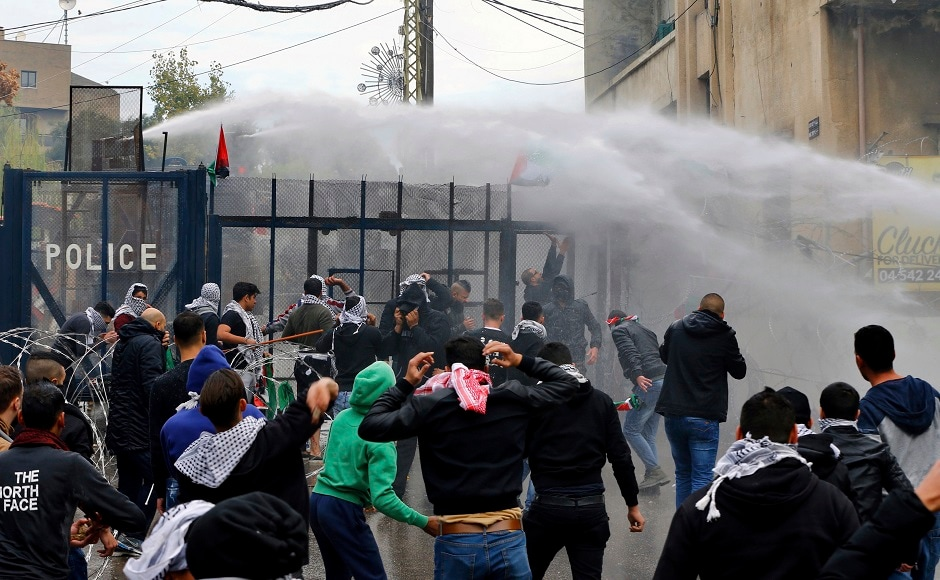 The Lebanese government has called on the protesters not to damage property in the area. The protesters burned effigy of Trump and threw stones at security forces, prompting them to respond by firing tear gas canisters and deploying water cannon. AP