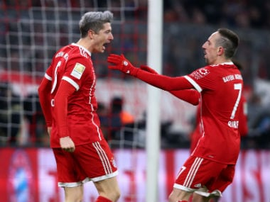 Bayern Munich's Robert Lewandowski celebrates scoring their first goal with Franck Ribery. Reuters