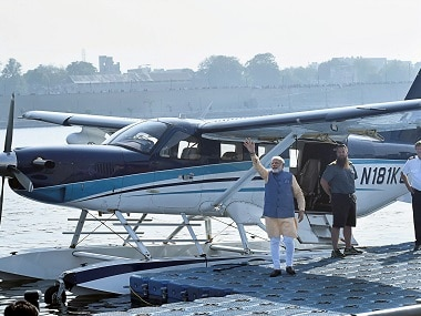 Prime Minister Narendra Modi waves to the crowd as he boards a seaplane in Gujarat. PTI