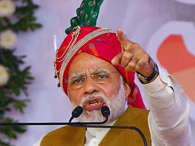 Prime Minister Narendra Modi addresses party supporters at a public meeting for Gujarat assembly election at Himmatnagar. PTI
