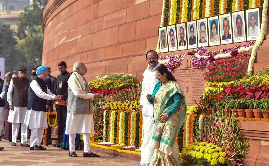 Days after bitter political slugfest ahead of the last phase of Gujarat polls, Prime Minister Narendra Modi and his predecessor Manmohan Singh on Wednesday greeted each other at an event to pay homage to the people who died in the 2001 Parliament attack. PTI