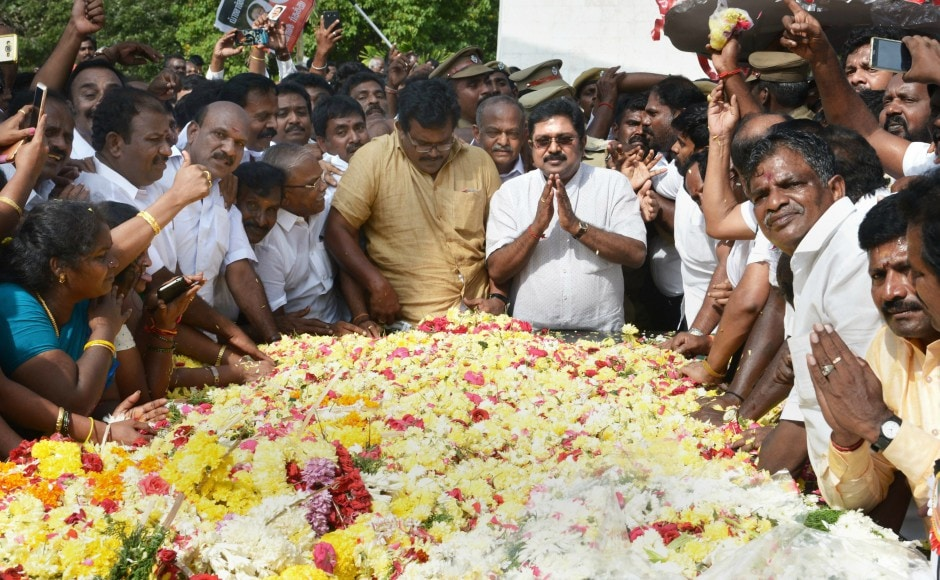 Dhinakaran offered floral tributes at the memorial of MG Ramachandran at Marina beach in Chennai on Sunday after winning the RK Nagar constituency bypoll. PTI
