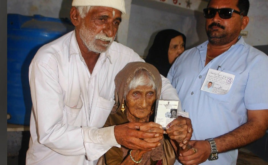 126-year-old Ajiben arrived at a poll booth to cast her vote in the first phase of Gujarat Assembly election in Rajkot on Saturday. PTI