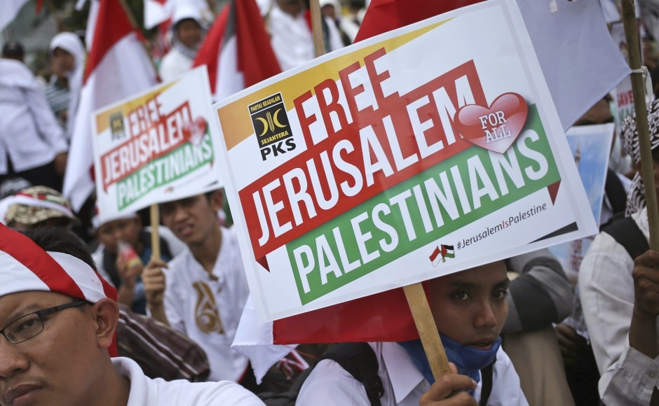 """Thousands protested outside the US Embassy in the Indonesian capital on Sunday against President Donald Trump's decision to recognize Jerusalem as Israel's capital, many waving banners saying """"Palestine is in our hearts"""". AP"""