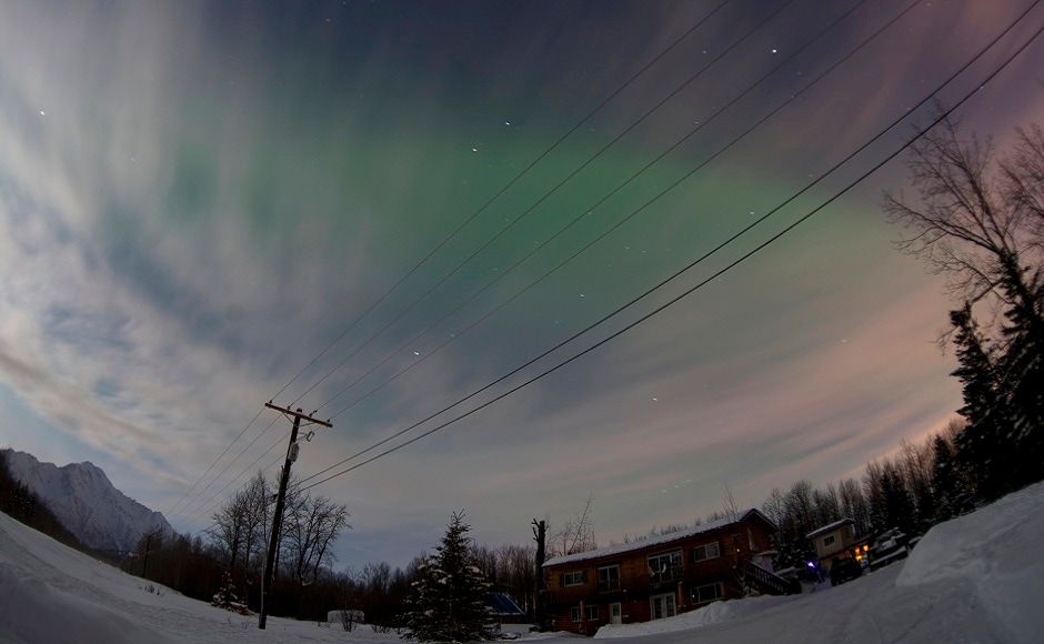 The Aurora Borealis is pictured above a house along the Old Glenn Highway, Alaska. REUTERS