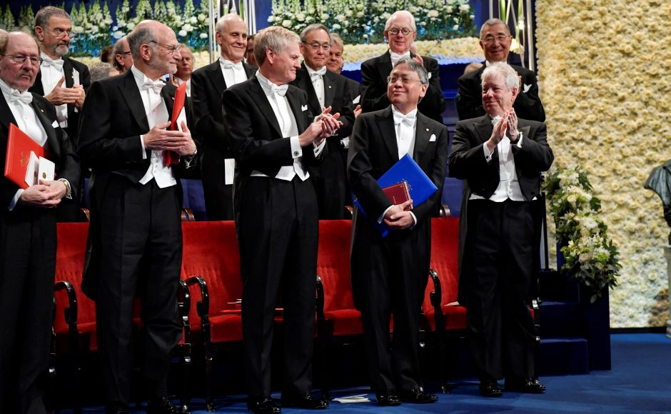 Jeffrey Hall, laureate in physiology or medicine, Michael Rosbash, laureate in physiology or medicine, Michael Young, laureate in physiology or medicine, Kazuo Ishiguro, laureate in literature and Richard Thaler, laureate in economics are seen during the Nobel Award Ceremony at the Concert House in Stockholm, Sweden. Reuters