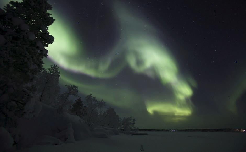 The Aurora Borealis (northern lights) illuminate the sky of Lapland region, in Inari, Finland. REUTERS