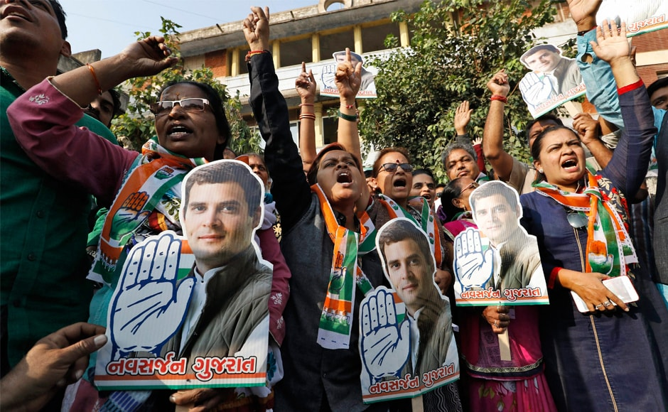 Congress party supporters hold a cut-out of newly appointed party chief Rahul Gandhi in Ahmedabad. Celebrations erupted after Rahul took over from mother Sonia Gandhi in New Delhi on Saturday. PTI