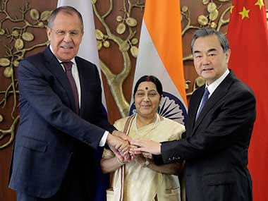 External affairs minister Sushma Swaraj poses with her Chinese counterpart Wang Yi and Russian counterpart Sergey Lavrov before their tri-lateral meeting in New Delhi. AP