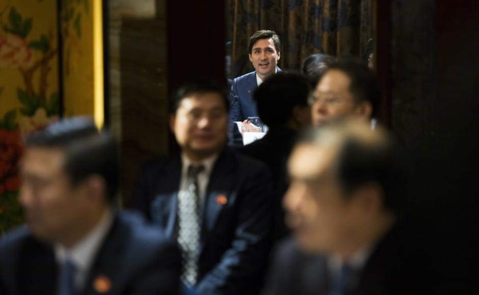Trudeau's Liberal government must weigh domestic unease at closer China ties with pressure from business interests for more access to the Chinese market. AP