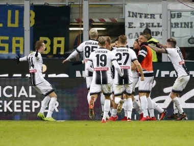 Udinese's Rodrigo De Paul, covered by his teammates celebrates after scoring during the Serie A match with Inter Milan. AP