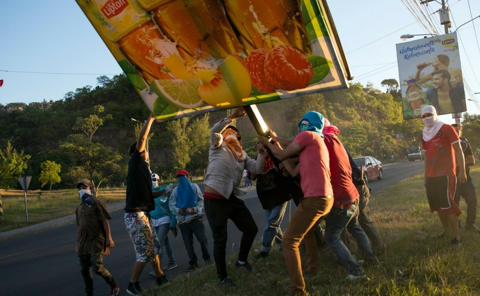 Thousands of Hondurans across the country blocked roads with viral footage of confrontations with police, who attempted to disperse demonstrators with tear gas, circulating on social media. AP