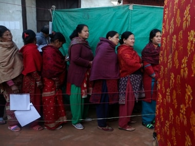 Nepalese women stand and wait on a queue to cast their vote during the legislative elections in Thimi. AP