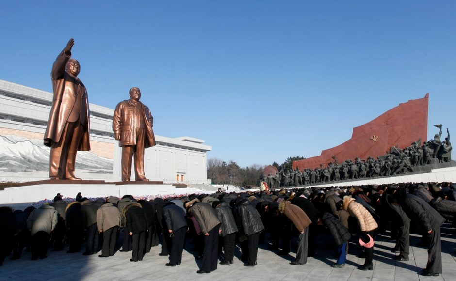 Thousands of North Koreans marched up Pyongyang's Mansu Hill to bow and place flowers at the feet of two giant bronze statues of Kim Jong II and national founder Kim II Sung. AP