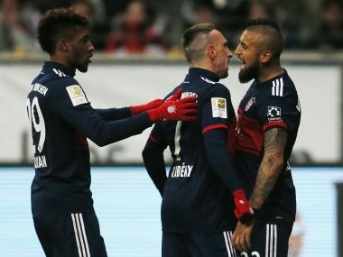 Bayern's Arturo Vidal (right) Franck Ribery, center, celebrate after a goal against Eintracht Frankfurt. AP
