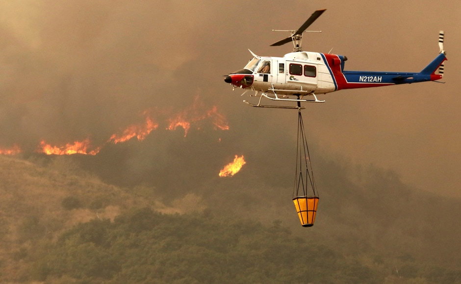 The water-dropping planes and helicopters essential were used to tame and contain the fire. AP