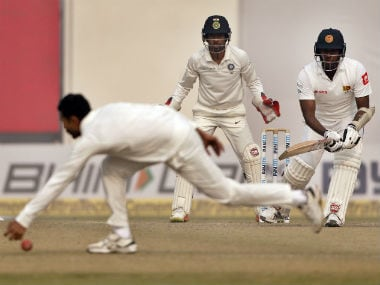 India's Ravindra Jadeja (2L) attempts to stop the ball after a shot is played by Sri Lanka's Angelo Mathews during the Day 3 of the third Test in Delhi. AP