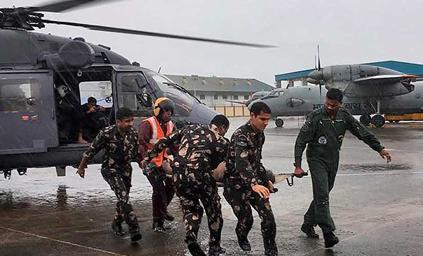 Stranded fisherman being brought to Kerala coast by Indain Navy personnel, in Kochi on Saturday. PTI