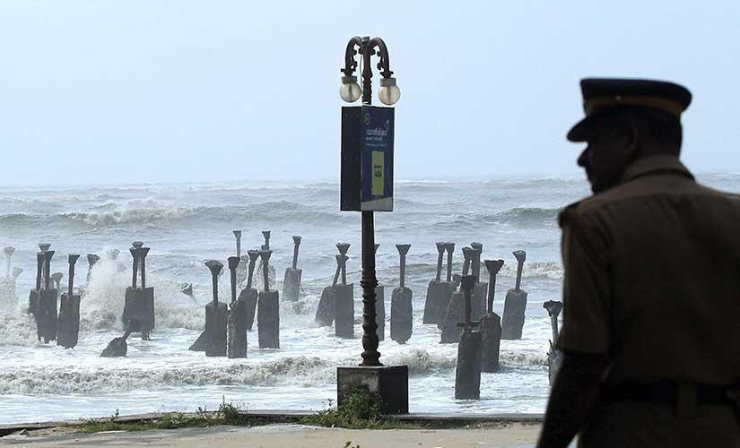 Police vigil in the beach during Ockhi cyclone alert in Kozhikode on Saturday. PTI